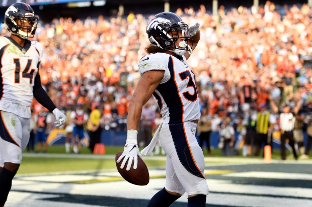 Running back Phillip Lindsay (30) of ...