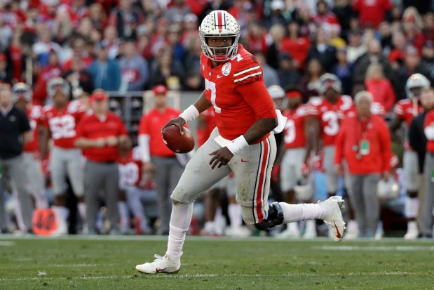 In this Jan. 1, 2019, file photo, Ohio State quarterback Dwayne Haskins runs against Washington during the first half of the Rose Bowl NCAA college football game, in Pasadena, Calif.
