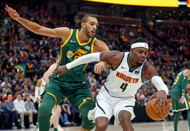 Utah Jazz center Rudy Gobert, left, ...
