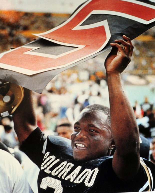 Former CU football player Darian Hagan holds up the No. 5, referring to the fifth down at Missouri.