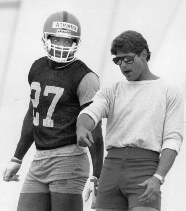 Steve Atwater listens to advice from Coach Charlie Waters during Broncos practice inside the bubble on May 16, 1989.