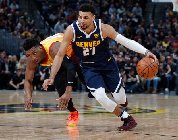 Denver Nuggets guard Jamal Murray, front, ...