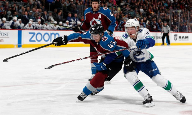 Colorado Avalanche defenseman Samuel Girard, left, ...