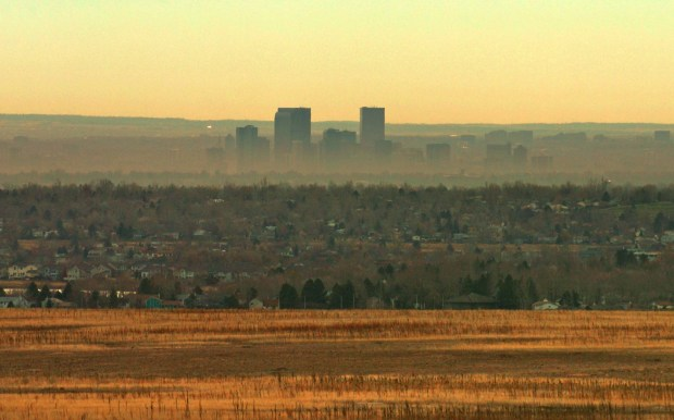 A brown cloud hangs over Denver as an inversion keeps much of the smog from moving out in this 2007 photo.