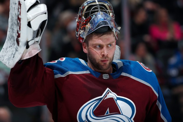 Colorado Avalanche goaltender Semyon Varlamov adjusts ...