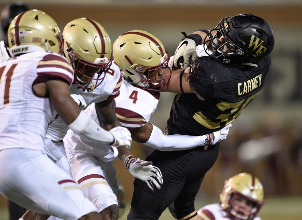 Hamp Cheevers (4) of the Boston College Eagles tackles Cade Carney (36) of the Wake Forest Demon Deacons during their game at BB&T Field on Sept. 13, 2018 in Winston Salem, N.C.