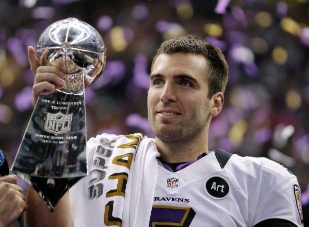 In this Feb. 13, 2013 file photo, Baltimore Ravens quarterback Joe Flacco (5) holds the Vince Lombardi Trophy after defeating the San Francisco 49ers 34-31 in the NFL Super Bowl XLVII football game in New Orleans.