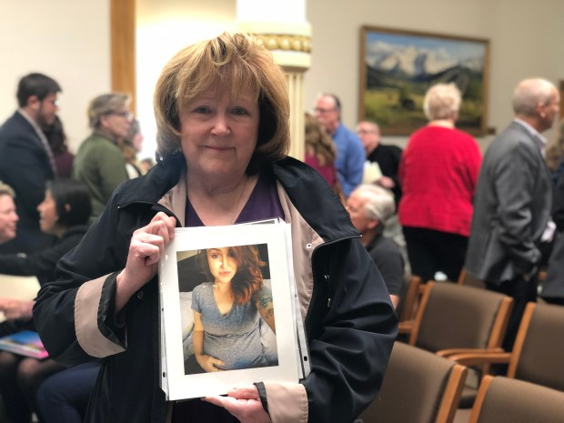 Adele Marshall holds a photo of her daughter Taryn Elkins, who died when she was seven months pregnant, after testifying to the Colorado House of Representatives on Feb. 13, 2019.