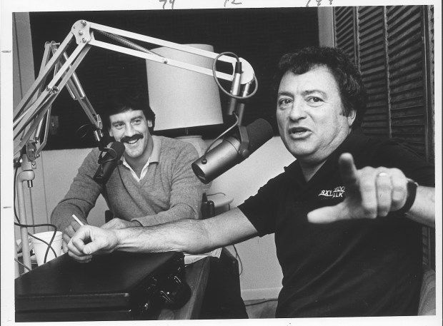 From left, Dave Logan and Irv Brown sit in the radio booth at KRXY, where they are talk show hosts.