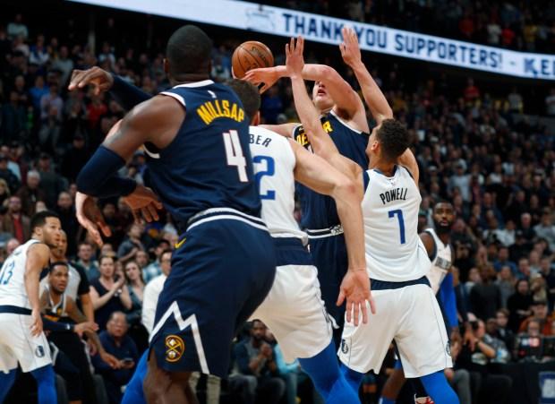 Denver Nuggets center Nikola Jokic, back, ...