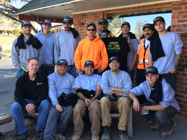 Employees with 1st Electric Contractors gather together for a picture.