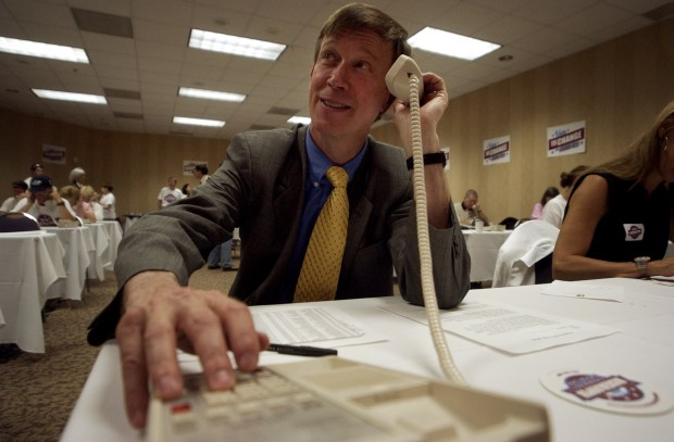 Candidate for mayor John Hickenlooper went ...
