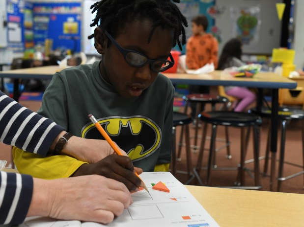 Tyree Howard, 5, gets help with ...