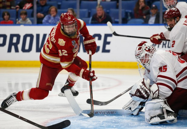 Massachusetts goalie Filip Lindberg (35) stops ...