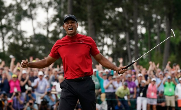 Tiger Woods reacts as he wins ...