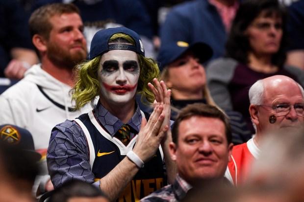 A Denver Nuggets fan dresses as ...