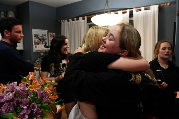 Katherine Griek, 18, left, gives a ...