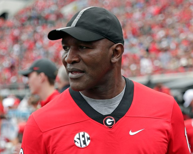 In this Oct. 27, 2019, file photo, former professional boxer Evander Holyfield paces the sidelines as he watches his son, Georgia running back Elijah Holyfield, play in an NCAA college football game against Florida, in Jacksonville, Fla.