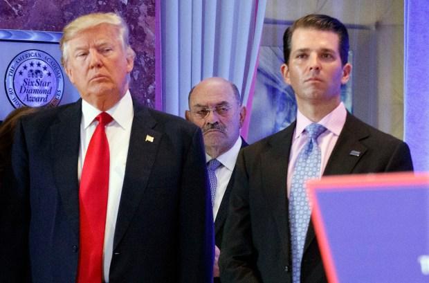 Center, stands between President-elect Donald ...