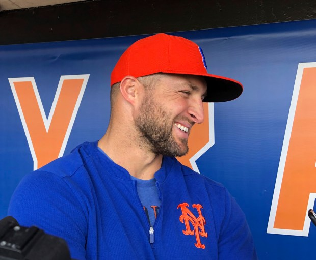 Syracuse Mets' Tim Tebow speaks with ...