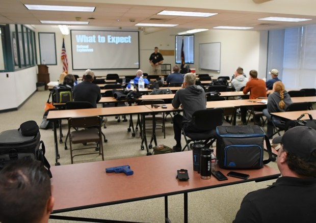 Sgt. Mike Touchton teaches officers, at ...