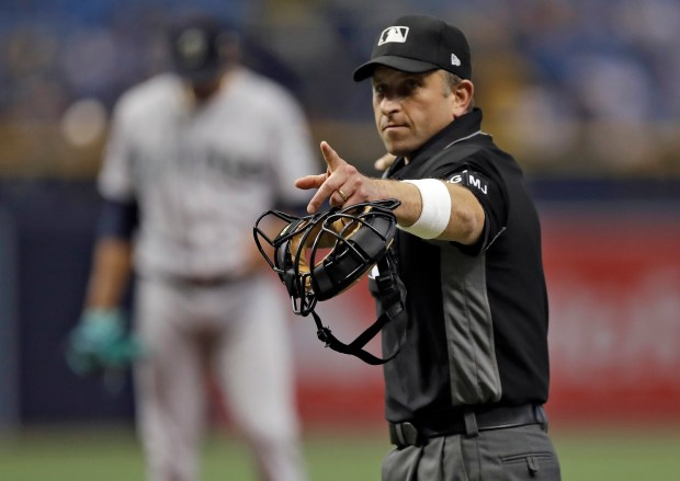 Home plate umpire Chris Guccione points ...