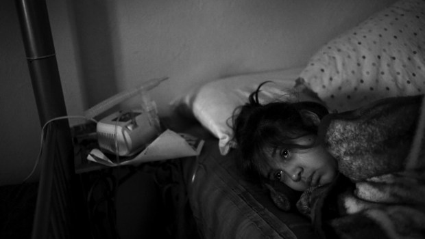 Annabel Rodriguez-Santos, 8, lies in bed ...