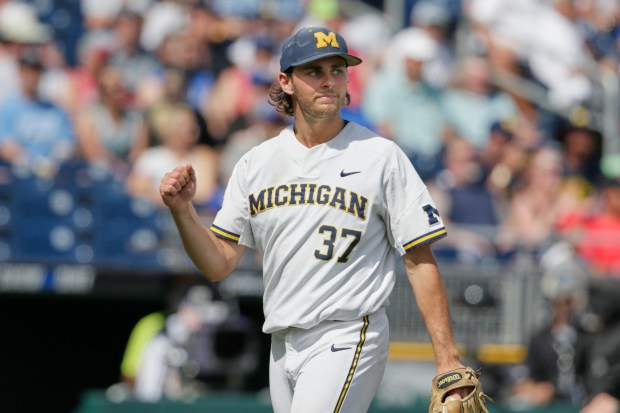 Michigan starting pitcher Karl Kauffmann (37) ...