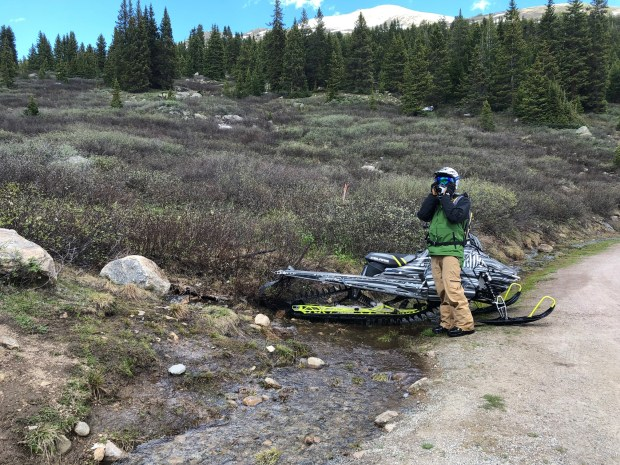 Snowmobilers ride on fragile Independence Pass tundra despite a lack of snow, spark concern