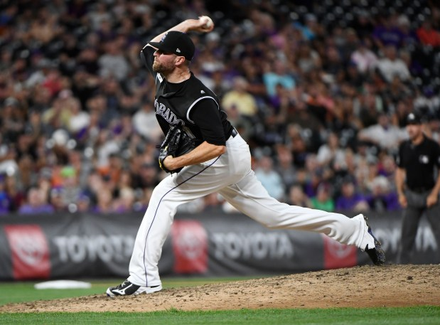 Colorado Rockies pitcher Wade Davis (71) ...