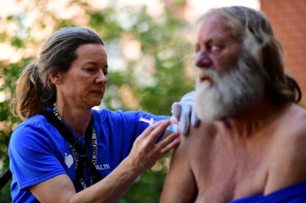 Denver Public Health nurse Maggie McClean, ...