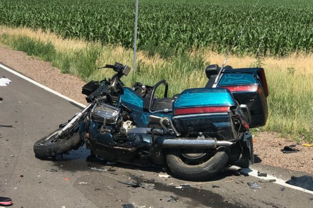 Two people died when pickup truck collides with motorcycle east of DIA