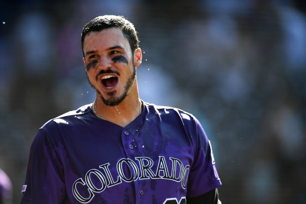 Nolan Arenado smiles after getting doused ...