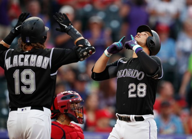 Colorado Rockies' Charlie Blackmon, left, waits ...