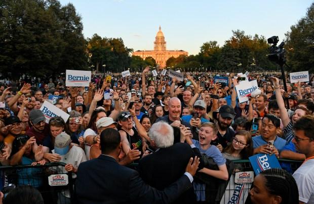 Presidential candidate Bernie Sanders shakes the ...