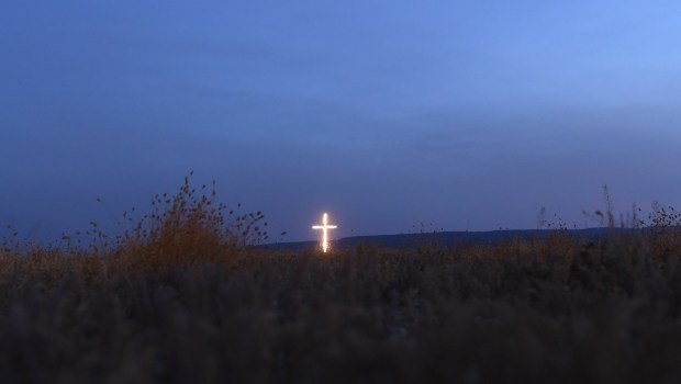 A cross lights up the night ...