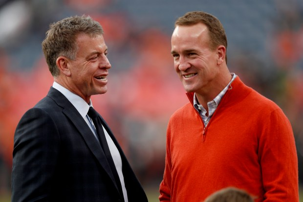 Former NFL quarterbacks Peyton Manning, right, ...