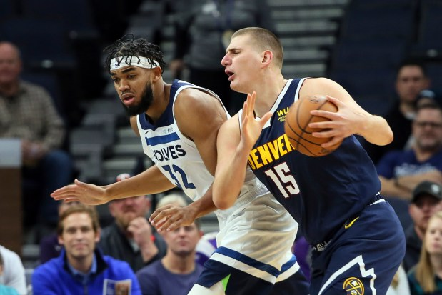 Denver Nuggets' Nikola Jokic, right, of ...