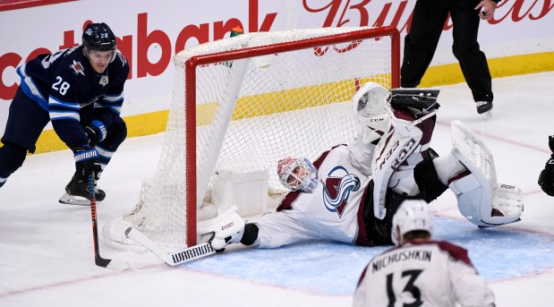 Colorado Avalanche goaltender Adam Werner (30) ...