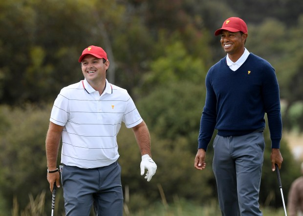 USA team's Patrick Reed, left, and ...