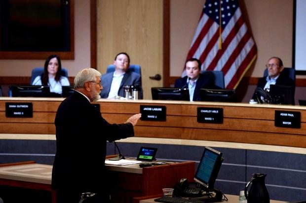 Attorney John Henderson speaks during public ...