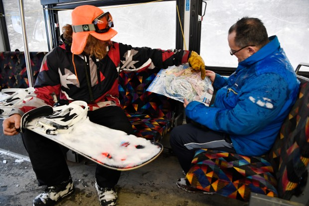 Local Snowboarder Christian Tichy, left, from ...