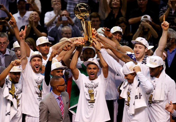 The San Antonio Spurs celebrate with ...