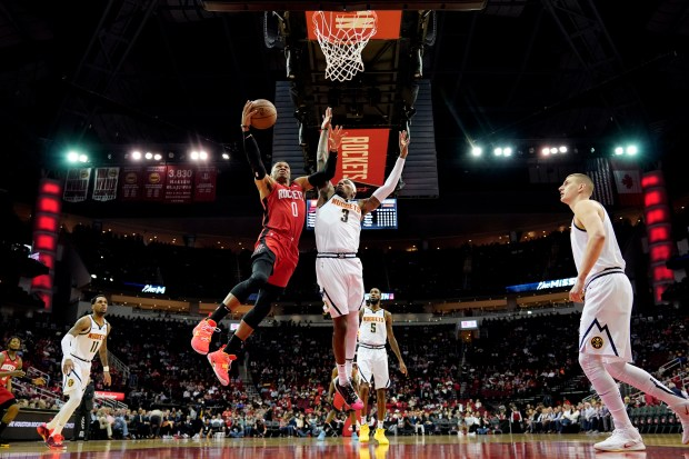 Houston Rockets' Russell Westbrook (0) goes ...