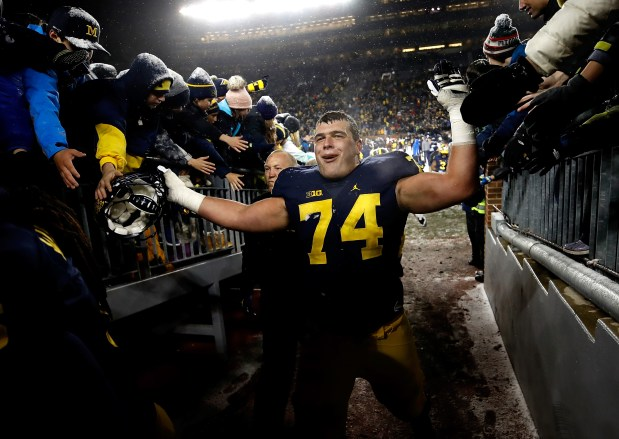 Ben Bredeson #74 of the Michigan ...