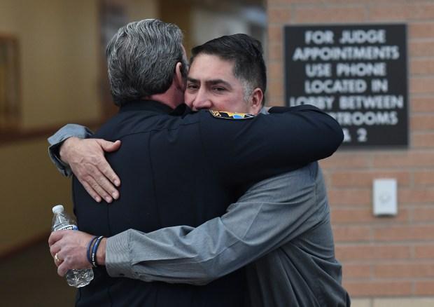 Douglas County Sheriff Tony Spurlock hugs ...