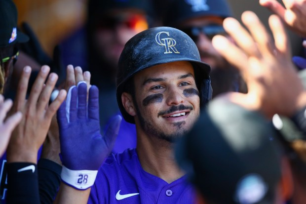 Colorado Rockies' Nolan Arenado smiles as ...