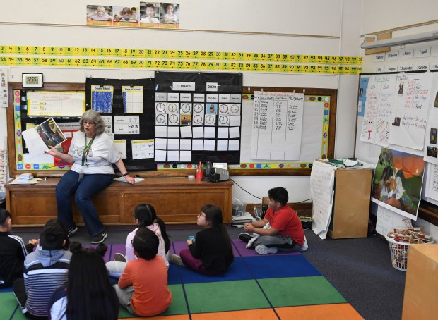 Kathy Eaton reads a story to ...