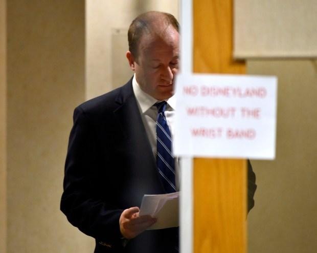 Governor of Colorado Jared Polis looks ...