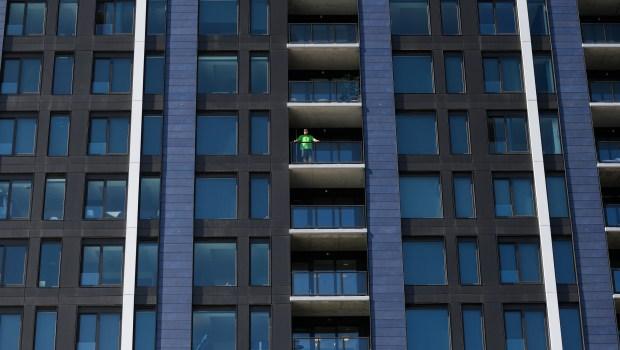 A man wearing a green shirt ...